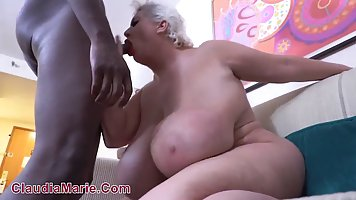 Plump mommy with huge milkings lifted legs for sex with a Negro