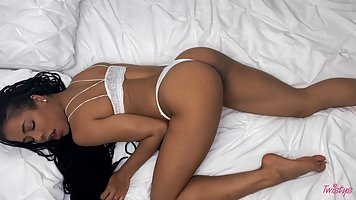 Skinny mulatto with navel piercing has a homemade handjob in bed