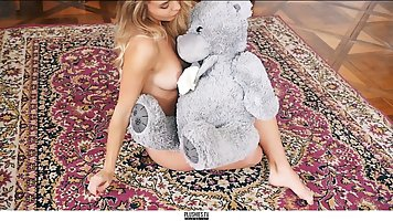 A gentle blonde rubs a beautiful pussy with a plush toy and ends up