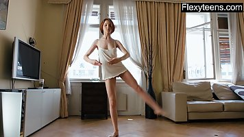 The ballerina shoots on camera and training and a gentle solo with an elastic pu...