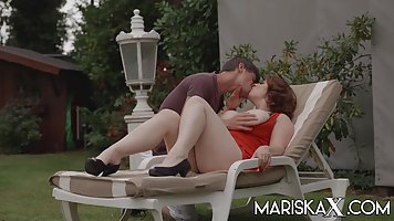Redhead in red bikini is ready for anal fucking on a deck chair from a young nei...