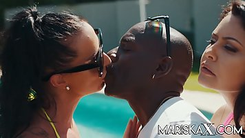 Ebony near the pool gets a hard threesome fuck with two busty brunettes