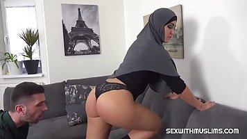 Arab woman in black uniform wants a tourist's long penis by the cheek and pussy