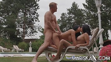 Two brunettes by the pool give the pool cleaner real threesome