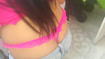 A brunette in pink panties and jeans decided to shoot a homemade striptease solo...
