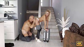 A young blonde with big milkings did not refuse an old man sex right at the stai...