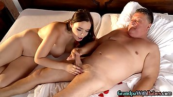 An old man with a strong dick fucks a young brunette with big milkings